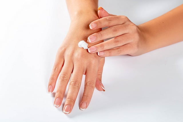 Picture of healthy skin, woman rubbing cream on hands