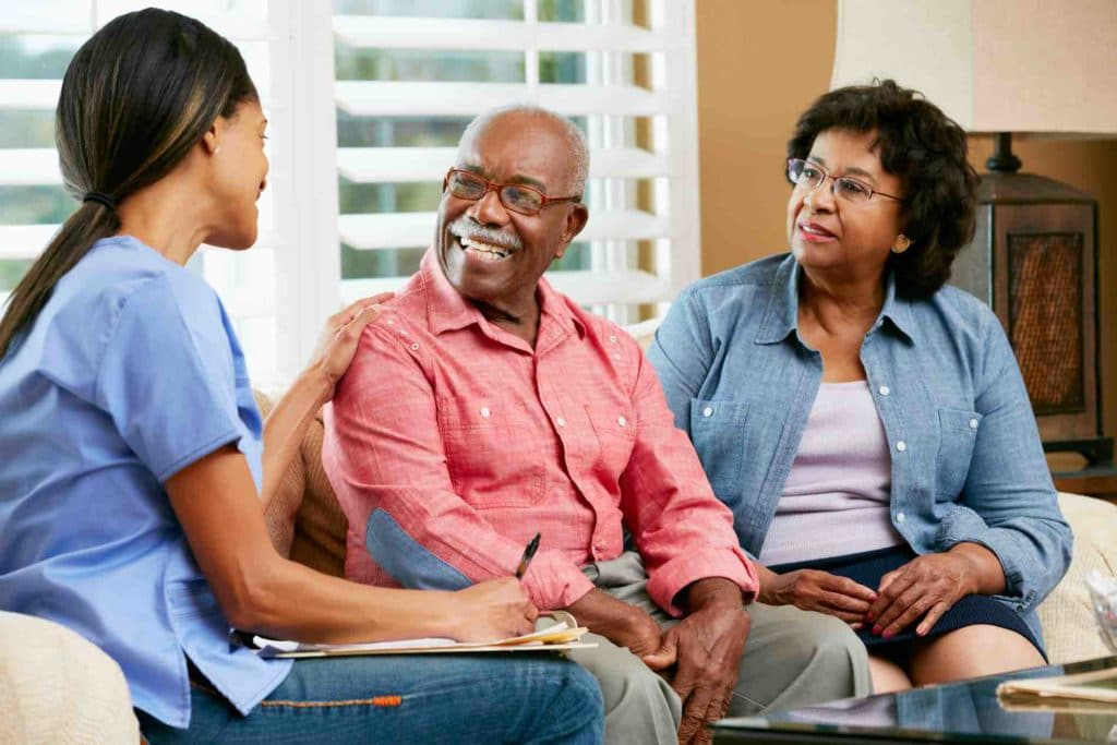 Family speaking with nurse
