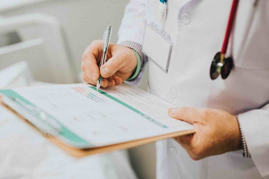 Physician writing a prescription